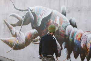 Louis Masai painting the Shasta Crayfish mural, Los Angeles, on 'The Art of Beeing' tour, Image: Tee Byford